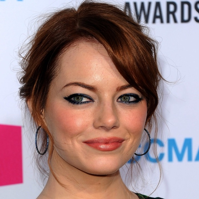 HOLLYWOOD, CA - JANUARY 12:  Actress Emma Stone arrives at the 17th Annual Critics' Choice Movie Awards held at The Hollywood Palladium on January 12, 2012 in Los Angeles, California.  (Photo by Jason Merritt/Getty Images)