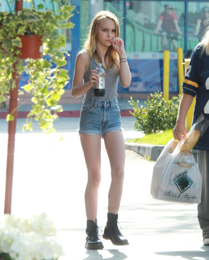 Johnny Depp's daughter Lily Rose Melody Depp doesn't seems to be handling her parents' separation very well as seen on this 4th of July where she went grocery shopping with her entourage. She's seen bitting her nails. Pictured: Lily Rose Melody Depp Ref: SPL413867  040712   Picture by: JLM / Splash News Splash News and Pictures Los Angeles:310-821-2666 New York:212-619-2666 London:870-934-2666 photodesk@splashnews.com