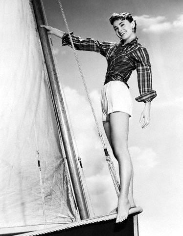 "22 Apr 1954, New York, New York, USA --- 4/22/1954-New York:Young Audrey Hepburn, whose professional star is sailing smoothly through the theatrical heavens, makes a pretty sight before the mast. The pixie-faced actress, who took this year's top acting prizes for stage and screen, will follow her Academy Award-winning movie performance with the starring role in ""Sabrina,"" soon to be released by Paramount. --- Image by © Bettmann/CORBIS"