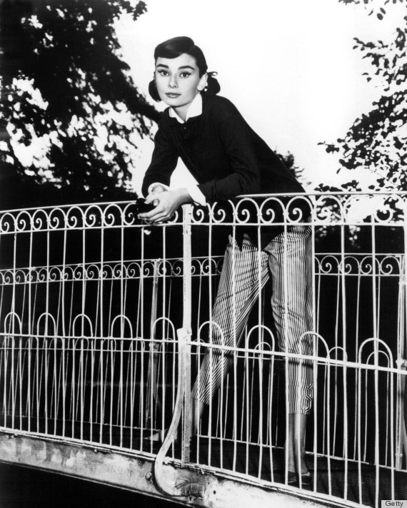 Belgian-born actress Audrey Hepburn (1929 - 1993) posing on a bridge, circa 1953. (Photo by Silver Screen Collection/Getty Images)